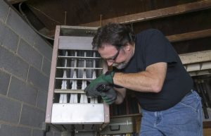 HVAC Technician Addressing Gas Furnace Problems